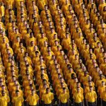 crowd of people in yellow shirts